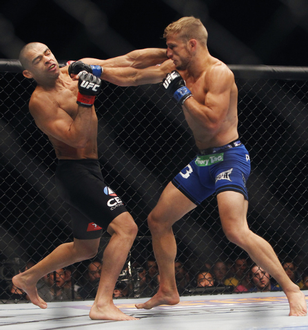 TJ Dillashaw, right, hits Renan Barao during UFC 173 at the MGM Grand Garden Arena in Las Vegas on Saturday, May 24, 2014. (Jason Bean/Las Vegas Review-Journal)