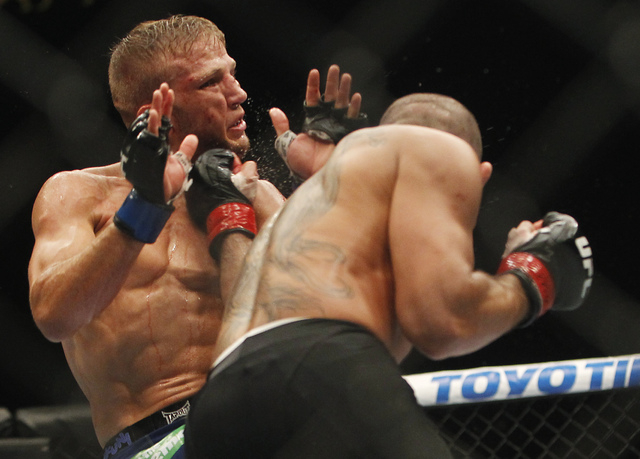 Renan Barao, right, lands an uppercut against TJ Dillashaw during UFC 173 at the MGM Grand Garden Arena in Las Vegas on Saturday, May 24, 2014. (Jason Bean/Las Vegas Review-Journal)