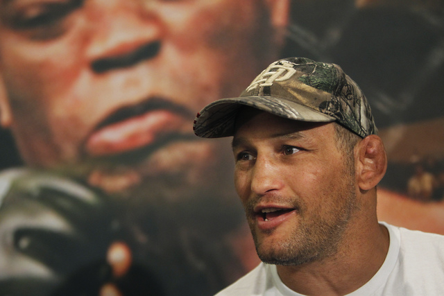 Fighter Dan Henderson talks with the press during media day for UFC 173 at the MGM Grand in Las Vegas on Thursday, May 22, 2014. Henderson is scheduled to take on Daniel Cormier in a light heavywe ...