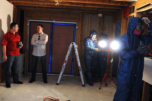 Will Dellaechaie, left, president of Summit Restoration Inc., and his business partner Michael Becker, owner of the general contracting firm PJ Becker and sons, talk inside a condominium during a  ...