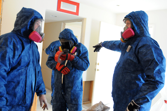 Technicians with Summit Restoration work inside a condominium at the Rain Tree West Complex in Las Vegas during a mold remediation project Tuesday, April 15, 2014. (Erik Verduzco/Las Vegas Review- ...