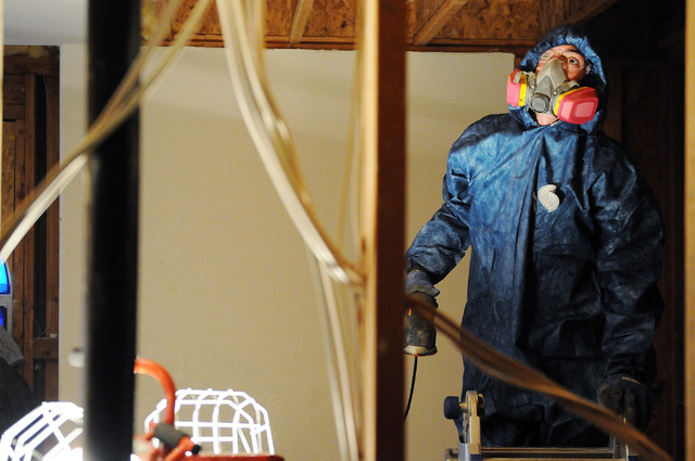 Jeff Dibble, technician at Summit Restoration Inc., inspects surfaces for mold during a remediation project inside a condominium at the Rain Tree West Complex in Las Vegas Tuesday, April 15, 2014. ...