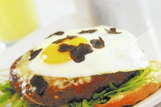 French Burger at Morels French Steakhouse, Palazzo: The open-faced tartine on white toast with whole-grain mustard, truffle cheese, mayonnaise, arugula and fried egg, and served with french fries, ...