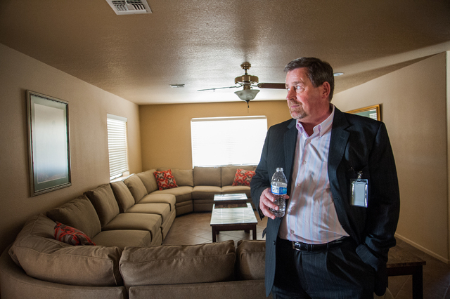 Central Recovery Treatment Director of Marketing Tom O'Neil gives a tour of Las Vegas Recovery Center residential homes at 7525 West Gowan Road on Friday, April 11, 2014. The center features 20 ne ...