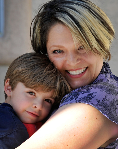 Jaylene Low, right, holds her son, Logan, 5, at their North Las Vegas home on Wednesday, April 23, 2014. Low has been cancer free for the last year since being diagnosed with breast cancer four ye ...