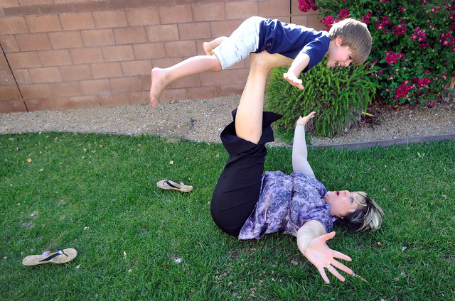 Jaylene Low plays with her son, Logan, 5, at their North Las Vegas home on Wednesday, April 23, 2014. Low has been cancer free for the last year since being diagnosed with breast cancer four years ...