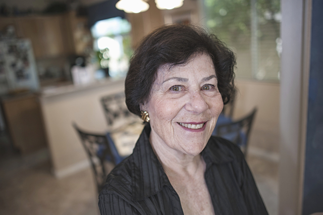 Raymonde Fiol, 77, who was recently named Senior Citizen of the Year for 2014, poses for a photo at her home in Las Vegas on Friday, May 9, 2014. Fiol lost her parents when she was five after they ...