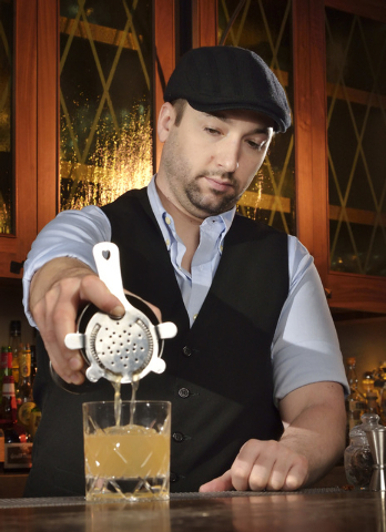 Chief mixologist Marshall Altier makes a Mark Twain at Rose.Rabbit.Lie in the Cosmopolitan hotel-casino at 3708 Las Vegas Blvd., South, in Las Vegas on Thursday, March 27, 2014. The drink is made  ...