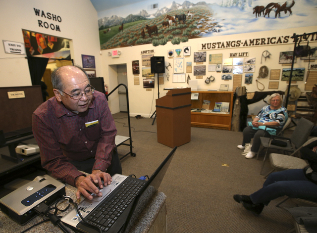 Nevada State Museum curator of anthropology and state paleontologist Gene Hattori sets up for a presentation on petroglyphs at the Carson Valley Museum & Cultural Center, in Gardnerville, Nev., on ...