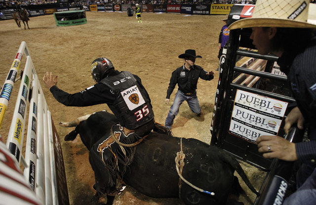 Markus Mariluch rides during the final night of the PBR Las Cowboy Standing at Mandalay Bay in Las Vegas Saturday, May 10, 2014. (John Locher/Las Vegas Review-Journal)