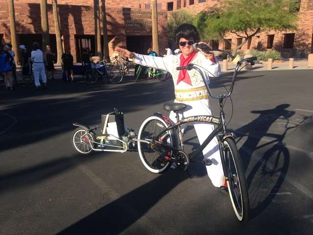 Ron Floth of the RTC bike program prepares for Elvis bike ride Friday night. (Alan Snel/Las Vegas Review-Journal)