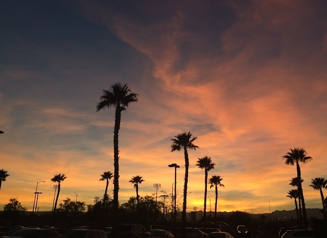 The sun sets behind the Spring Mountains on Feb. 14, 2014. (Stephanie Grimes/Las Vegas Review-Journal)