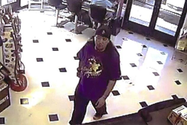 The person of interest is described as being 21 to 26 years old, about 5 feet 10 inches tall with a medium build. He has tattoos under his left eye, left wrist, and right forearm. (Courtesy)