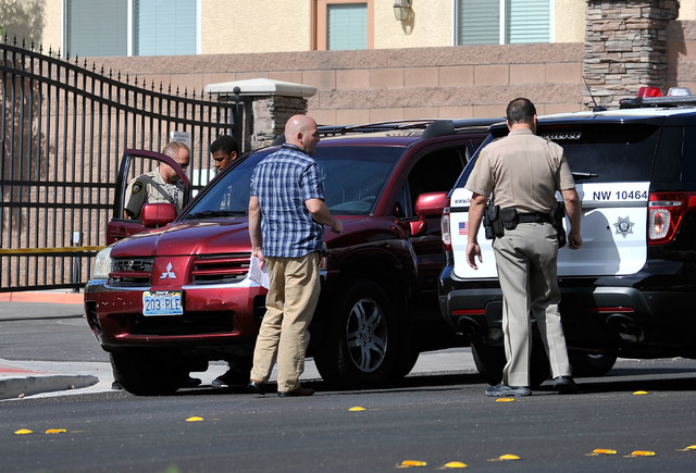 A suspect is loaded into a vehicle by Las Vegas police after a morning event near Severance Lane and Grapewood Street in Centennial Hills on Thursday, May 22, 2014. Las Vegas police responded to a ...