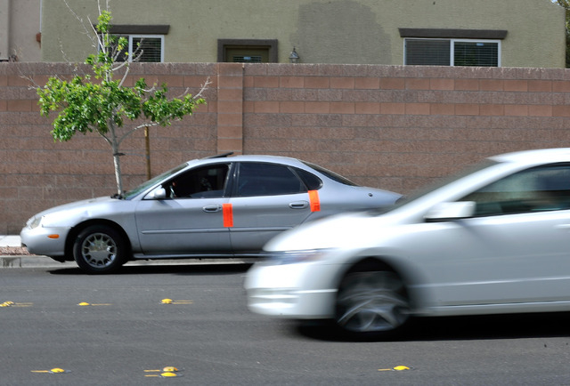 A suspect's vehicle is parked along Severance Lane at Grapewood Street waiting to be towed after Las Vegas police responded to a reported robbery on Thursday, May 22, 2014. Las Vegas police arrest ...