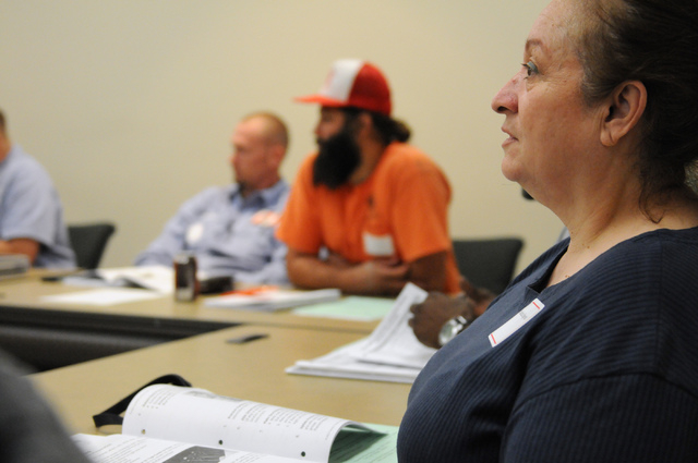 Rosalina Hagewood, a bilingual Spanish speaker, listens during a poll worker training class at the Clark County Election Center Office in North Las Vegas Wednesday, May 21, 2014. (Erik Verduzco/La ...