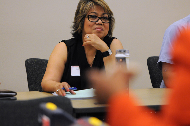 Maria Grace Hill, a bilingual Tagalog speaker, listens during a poll worker training class at the Clark County Election Center Office in North Las Vegas Wednesday, May 21, 2014. (Erik Verduzco/Las ...
