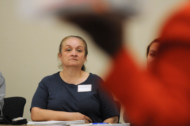Rosalina Hagewood, a bilingual Spanish speaker, listens during a poll worker training class at the Clark County Election Center Office in North Las Vegas Wednesday, May 21, 2014. Hagewood is one o ...