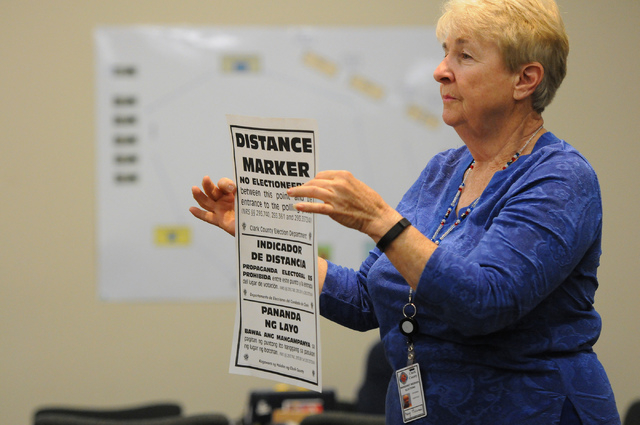 Program assistant instructor Marg Biesiada shows volunteers signage they will handle during a poll worker training class at the Clark County Election Center Office in North Las Vegas Wednesday, Ma ...
