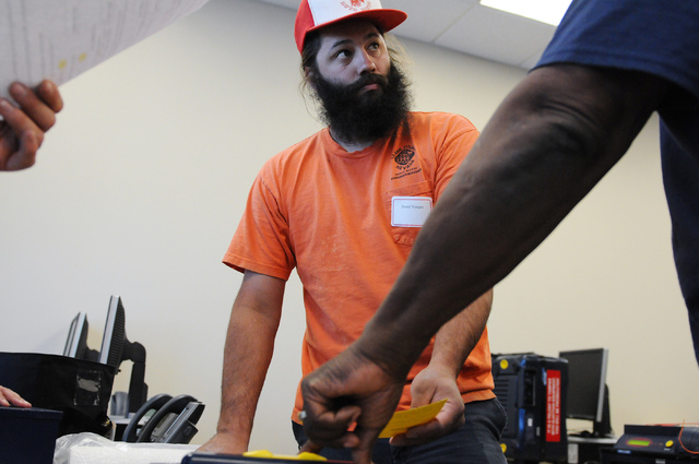 Volunteer David Vargas learns to use poll card activation machines during a poll worker training class at the Clark County Election Center Office in North Las Vegas Wednesday, May 21, 2014. (Erik  ...