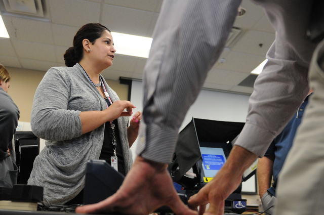 Program assistant instructor Yvette Dallas trains volunteers about handling poll card activation machines during a poll worker training class at the Clark County Election Center Office in North La ...