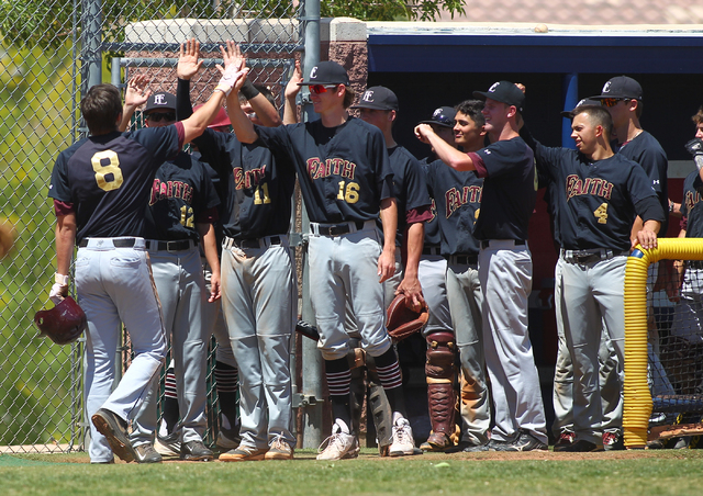 Faith Lutheran's Erich Uelman (8) celebrates his home run with teammates in the third inning of a baseball game at Coronado High School in Henderson on Saturday, May 3, 2014. Faith Lutheran won 11 ...
