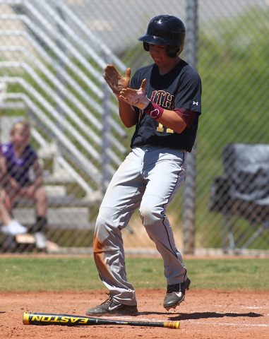 Faith Lutheran's Chad Jones (7) claps after scoring a run against Coronado in the second inning of a baseball game at Coronado High School in Henderson on Saturday, May 3, 2014. Faith Lutheran won ...