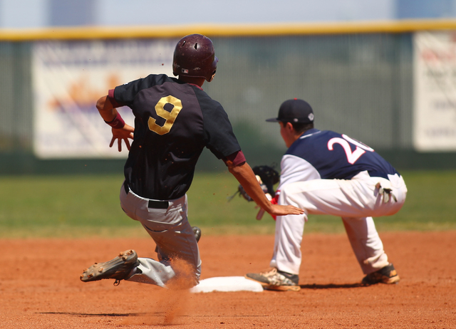 Faith Lutheran's Joshua Harmonay (9) is forced out at second as Coronado's Anthony Olheiser (20) catches the throw in the first inning of a baseball game at Coronado High School in Henderson on Sa ...