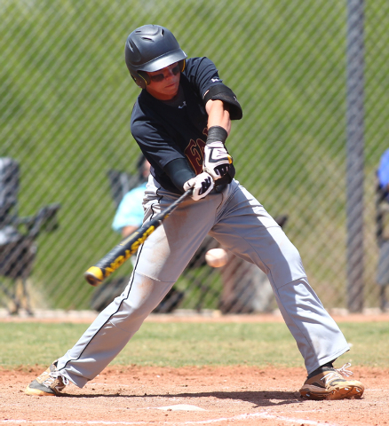 Faith Lutheran's Zach Trageton (11) hits the ball while playing against Coronado in the fourth inning of a baseball game at Coronado High School in Henderson on Saturday, May 3, 2014. Faith Luther ...