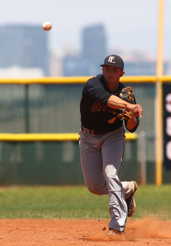 Faith Lutheran's Logan Etherington (4) throws to first base while playing against Coronado in the third inning of a baseball game at Coronado High School in Henderson on Saturday, May 3, 2014. Fai ...