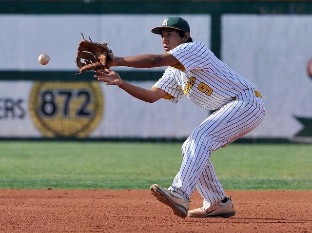 Rancho shortstop Juan Cruz fields the ball against Green Valley on Tuesday. Green Valley won, 10-4. (David Becker/Las Vegas Review-Journal)