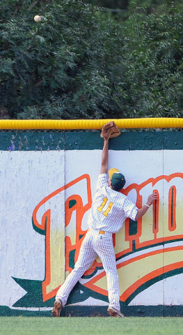 Rancho's Richmond Ashworth watches Green Valley's Keaton Smith's home run ball fly over the left field wall on Tuesday. The Gators hit three homers in a 10-4 win to lock up the Northeast League ti ...