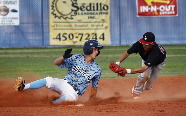 Centennial's Alex Nicoll (13) slides under the tag of Las Vegas' Hector Perez while hitting a double in the fifth inning of Friday's game. Nicoll was 2-for-3 with two doubles and an RBI in the Bul ...