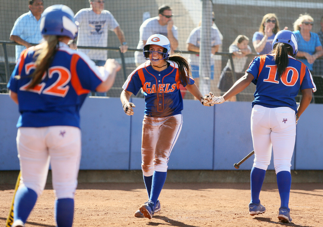 Bishop Gorman's Shelby Estocado, center, celebrates with teammates Dayton Yingling, left, and Jasmine Gibson, right, after scoring a run during the Gaels' 7-6 win over Shadow Ridge in the Sunset R ...