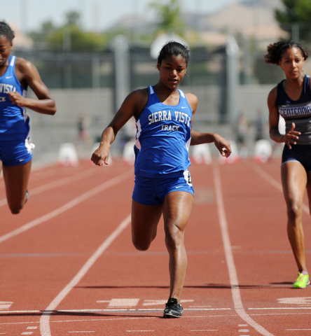 Sierra Vista's Morgan O'Neal, center, finishes first during the girls 100-meter-dash competition at the Sunrise and Sunset Region track meet semifinals at Palo Verde High School in Las Vegas Satur ...