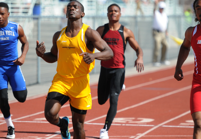 Bonanza's Jayveon Taylor, center, finishes first during the boys 100-meter-dash competition at the Sunrise and Sunset Region track meet semifinals at Palo Verde High School in Las Vegas Saturday,  ...