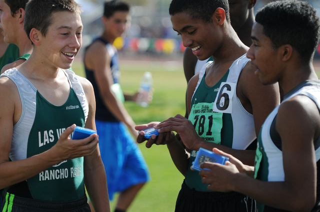 Rancho's 3,200 relay boys team Chase Norberg, from left, Lorenzo Johnson and Novell Reid, hold their first place medals following their race at the Sunrise and Sunset Region track meet semifinals  ...