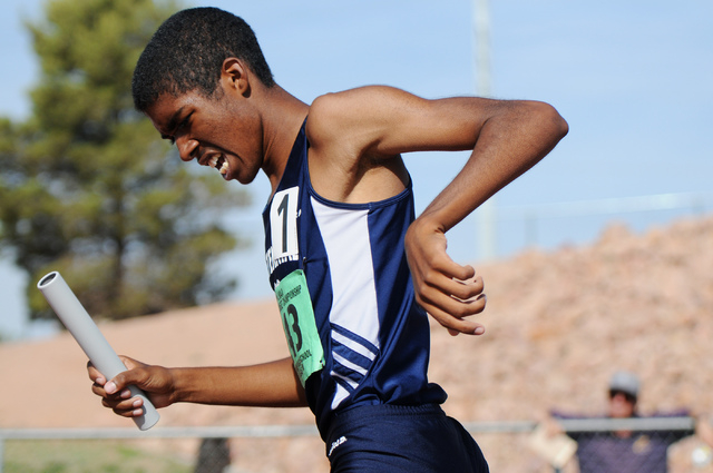 Centennial's Bryan Espino finishes first in the boys 3,200 relay team competition at the Sunrise and Sunset Region track meet semifinals at Palo Verde High School in Las Vegas Saturday, May 17, 20 ...
