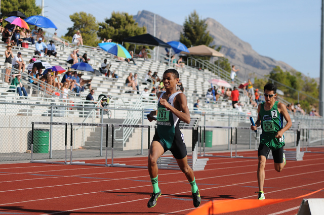 Rancho's Lorenzo Johnson, left, finishes first followed by Green Valley's Lenny Rubi during the boys 3,200 relay team competition at the Sunrise and Sunset Region track meet semifinals at Palo Ver ...
