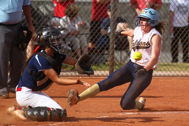 Foothill's Kelsey McFarland slides safely into home plate as Coronado's Basia Query waits for the throw on Wednesday. The Falcons won, 8-7. (Chase Stevens/Las Vegas Review-Journal)