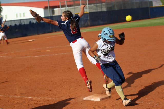 Foothill's Kiela Lizares (7) makes it safely to first base as the throw sails past Coronado's Marissa Kopp (8) on Wednesday. The Falcons won, 8-7. (Chase Stevens/Las Vegas Review-Journal)