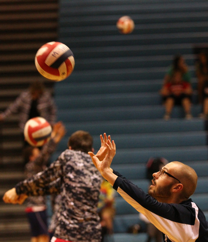 Coronado senior Michael Tatalovich, a cancer survivor, warms up before the team takes on Foothill  in a volleyball game at Foothill High School in Henderson on Wednesday, May 7, 2014. (Chase Steve ...