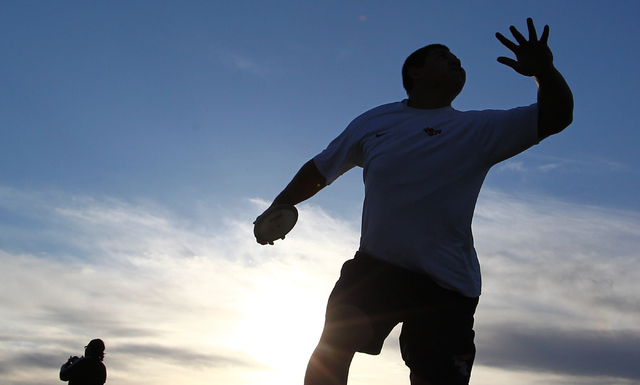 Liberty senior Reno Tu'ufuli, shown practicing Tuesday, has the third-best discus throw in the nation among high school athletes this season (196 feet, 10 inches) and the 16th-best shot put (61- ...