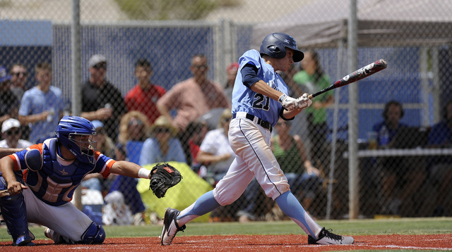 Centennial pitcher Cooper Powell hits an RBI single in the first inning against the Bishop Gorman during the Sunset Region championship game on Saturday. Powell threw a five-hitter and went 2-for- ...