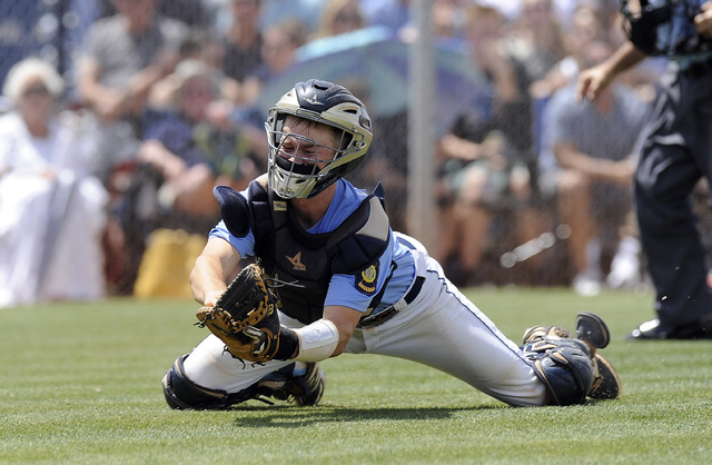 Centennial catcher Hayden Grant makes a diving catch in foul territory to retire Bishop Gorman's Grant Robbins during the Sunset Region title game on Saturday. Centennial beat the Gaels, 3-1. (Jos ...