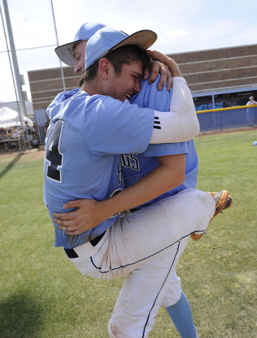 Centennial shortstop Jake Portaro, left, and designated hitter William Loucks embrace after the Bulldogs defeated Bishop Gorman 3-1 in the Sunset Region title game on Saturday. (Josh Holmberg/Las  ...