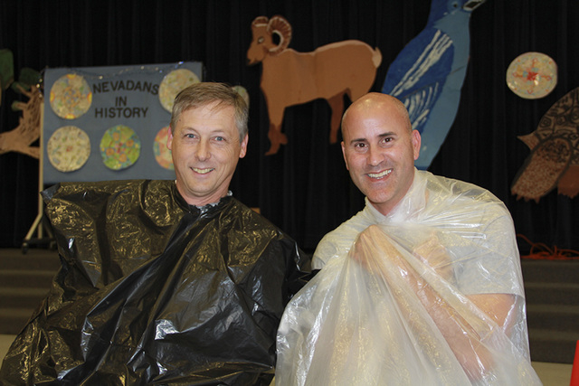 Richard H. Bryan Elementary principal Steve Piccininni, right, is seen in fall 2013 with the school's former assistant principal, Mark Norman, at an event to celebrate the students meeting their g ...