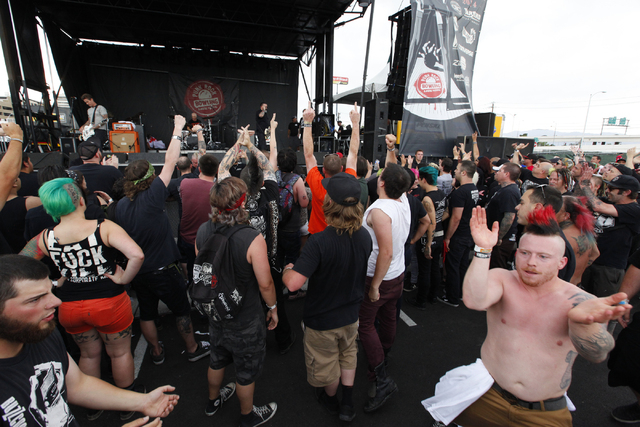 Fans cheer as Devil's Brigade performs at the Punk Rock Bowling music festival in downtown Las Vegas on Saturday, May 24, 2014. (Chase Stevens/Las Vegas Review-Journal)
