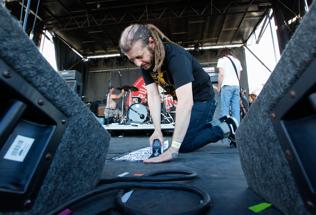 Keith Morris, vocalist of OFF!, tapes the band's setlist to the stage before performing at the Punk Rock Bowling music festival in downtown Las Vegas on Monday, May 26, 2014. (Chase Stevens/Las Ve ...