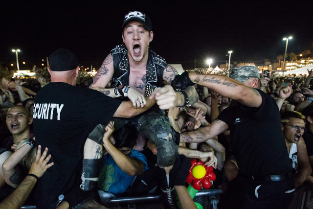 A crowd-surfing fan is seen as the Descendents perform at the Punk Rock Bowling music festival in downtown Las Vegas on Sunday, May 25, 2014. (Chase Stevens/Las Vegas Review-Journal)